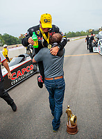 Aug 19, 2018; Brainerd, MN, USA; NHRA top fuel driver Billy Torrence celebrates with son Steve Torrence after winning the Lucas Oil Nationals at Brainerd International Raceway. Mandatory Credit: Mark J. Rebilas-USA TODAY Sports