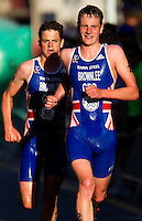 25 JUN 2011 - PONTEVEDRA, ESP -  Alistair Brownlee (GBR) (right) and his brother Jonathan Brownlee (GBR) (left) lead the run at the Elite Men's European Triathlon Championships in Pontevedra, Spain (PHOTO (C) NIGEL FARROW)