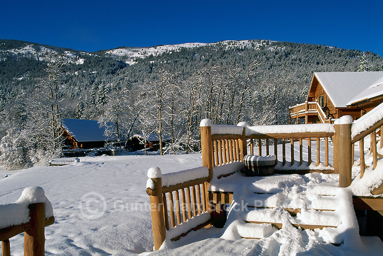 Snow Covered Log Cabins at Chilko Lake and Ts'yl-os Provincial Park, Cariboo Chilcotin Coast Region, BC,  British Columbia, Canada - Winter
