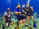 26 July 2015: A group of SCUBA divers from Minnesota pose for a photo at Ocean Pointe Reef, on the North Shore of Grand Cayman Island. Located in the British West Indies in the Caribbean, the Cayman Islands are renowned for excellent scuba diving, snorkeling, beaches and banking.  Mandatory Credit: Ed Wolfstein Photo *** RAW (NEF) Image File Available ***
