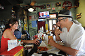Alex Carter serves customer Mark McGrain a Barq's rootbeer and a catfish po-boy  at the Parkway Bakery & Tavern in New Orleans, Sunday, July 4, 2010...( Photo/Cheryl Gerber)Louisiana Seafood..