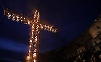 Una croce illuminata dalle fiaccole in occasione della Via Crucis celebrata dal Papa al Colosseo, Roma, 18 aprile 2014. <br /> A cross is lightened on the occasion of the Via Crucis (Way of the Cross) torchlight procession celebrated by the Pope at the Colosseum, Rome, 18 April 2014.<br /> UPDATE IMAGES PRESS/Isabella Bonotto<br /> <br /> STRICTLY ONLY FOR EDITORIAL USE