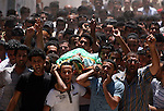 Palestinian mourners carry the body of Ibrahim Sarhan, killed by Israeli military, during his funeral in the West Bank refugee camp of El Fara, north of Nablus, Wednesday, July 13, 2011. Sarhan was killed Wednesday in an Israeli military raid on a West Bank refugee camp, Palestinians said, when Israeli troops had entered the El Fara camp in pursuit of a fugitive militant. According to witnesses residents began throwing stones at the troops, who responded with live fire, killing Sarhan. Photo by Issam Rimawi