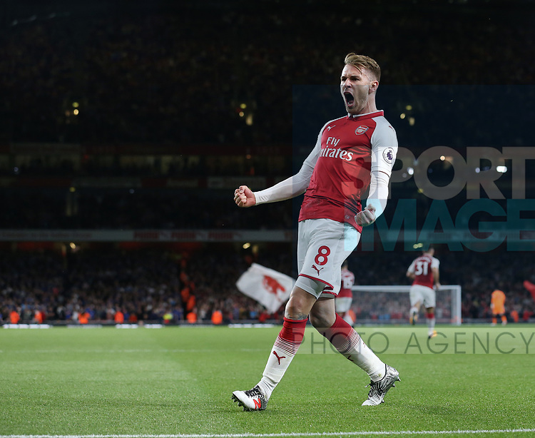Arsenal's Aaron Ramsey celebrates scoring his sides third goal during the premier league match at the Emirates Stadium, London. Picture date 11th August 2017. Picture credit should read: David Klein/Sportimage