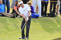 Miguel Angel Jimenez (ESP) chips onto the 14th green during Thursday's Round 1 of the 145th Open Championship held at Royal Troon Golf Club, Troon, Ayreshire, Scotland. 14th July 2016.<br /> Picture: Eoin Clarke | Golffile<br /> <br /> <br /> All photos usage must carry mandatory copyright credit (&copy; Golffile | Eoin Clarke)