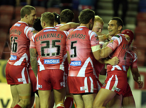 19.08.2011 Engage Super League Rugby from the DW Stadium. Wigan v Bradford. The Wigan team celebrate the scoring of another try.