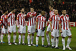 The home players waiting to shake hands with their opponents on the pitch at the Britannia Stadium, Stoke-on-Trent, before the UEFA Europa League last 32 first leg between Stoke City and visitors Valencia. The match ended in a 1-0 victory from the visitors from Spain. Mehmet Topal scored the only goal in the first half in a match watched by a crowd of 24,185.
