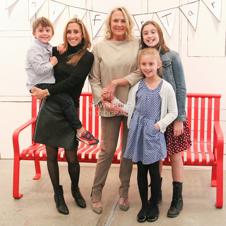 Renee Ehrlich Kalfus (center) poses with guests at the Annie For Target collection celebration and pop-up shop at Stage 37 in New York City on November 4, 2014.