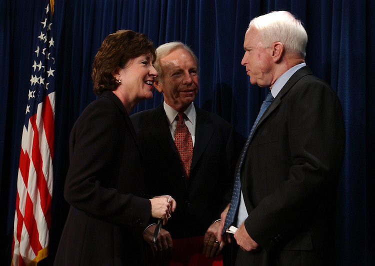Sen. Sue Collins, R-Me., speaks with Sens. Joe Lieberman, D-Conn., and Sen. John McCain, R-Ariz., after a news conference which discussed the Intelligence Reform Bill with