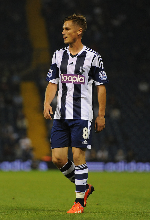West Bromwich Albion's Markus Rosenberg in action during todays match  <br /> <br /> Photo by Ashley Crowden/CameraSport<br /> <br /> Football - Capital One Cup Second Round - West Bromwich Albion v Newport County - Tuesday 27th August 2013 - The Hawthorns - West Bromwich<br />  <br /> &copy; CameraSport - 43 Linden Ave. Countesthorpe. Leicester. England. LE8 5PG - Tel: +44 (0) 116 277 4147 - admin@camerasport.com - www.camerasport.com