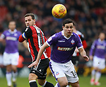 Billy Sharp of Sheffield Utd tussles with Josh Cullen of Bolton Wanderers during the Championship match at Bramall Lane Stadium, Sheffield. Picture date 30th December 2017. Picture credit should read: Simon Bellis/Sportimage