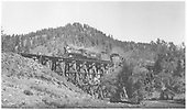 RGS 2-8-0 #74 with Rocky Club excursion train crossing Dead Horse Gulch trestle (Bridge 19-A).<br /> RGS  Wade, CO  9/1/1951