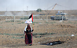 Palestinian protesters gather during clashes with Israeli troops in tents protest where Palestinians demand the right to return to their homeland at the Israel-Gaza border, in east of Gaza city on September 7, 2018. Photo by Atia Darwish