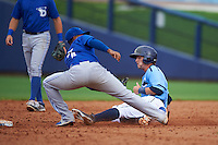Charlotte Stone Crabs outfielder Marty Gantt (7) slides into second as shortstop Richard Urena (7) gets the throw during a game against the Dunedin Blue Jays on July 26, 2015 at Charlotte Sports Park in Port Charlotte, Florida.  Charlotte defeated Dunedin 2-1 in ten innings.  (Mike Janes/Four Seam Images)