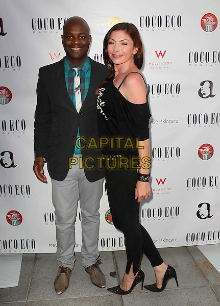 Joseph Hobbs, Anna Griffin.Coco Eco Green Emmy Suite Held at At W Hollywood Hotel, Hollywood, California, USA..September 19th, 2012.full length black suit jacket green shirt grey gray trousers off the shoulder top side .CAP/ADM/FS.©Faye Sadou/AdMedia/Capital Pictures.