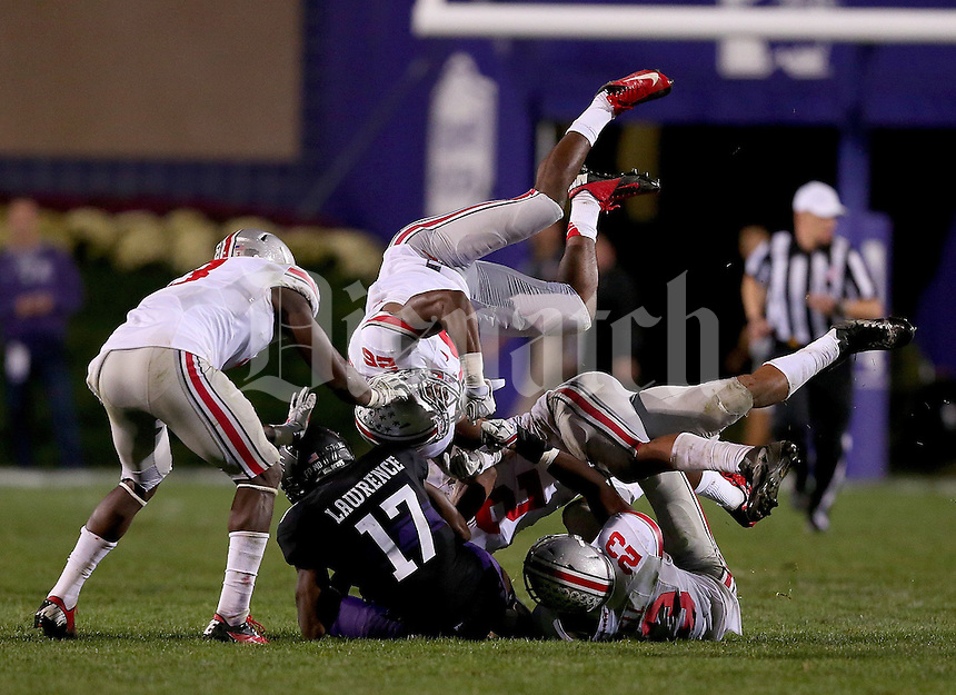 Ohio State Buckeyes cornerback Armani Reeves (26) goes up top on a tackle of Northwestern Wildcats wide receiver Rashad Lawrence (17) during the second half of the NCAA football game between Ohio State and Northwestern at Ryan Field in Evanston, Illinois on Saturday, October 5, 2013. (Columbus Dispatch photo by Jonathan Quilter)