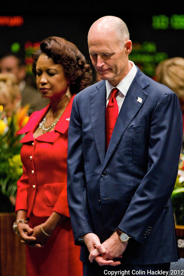 TALLAHASSEE, FLA. 1/10/12-OPENING011012 CH-Gov. Rick Scott, right, and Lt. Gov. Jennifer Carroll, left, pray in the Senate chamber during the opening day of the 2012 legislative session, Tuesday at the Capitol in Tallahassee...COLIN HACKLEY PHOTO