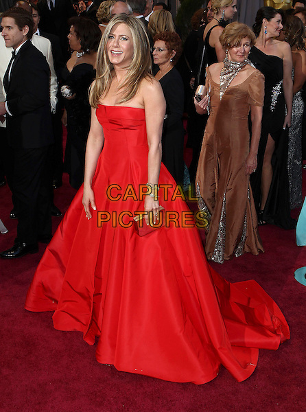 Jennifer Aniston (wearing Valentino).85th Annual Academy Awards held at the Dolby Theatre at Hollywood & Highland Center, Hollywood, California, USA..February 24th, 2013.oscars full length red strapless dress gown silver clutch bag  .CAP/ADM/SLP/COL.©Colin/StarlitePics/AdMedia/Capital Pictures