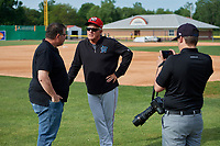 Batavia Muckdogs manager Tom Lawless conducts an interview with the Batavia Daily News Jon Anderson (left) and Alex Brasky (right) during practice on June 12, 2019 at Dwyer Stadium in Batavia, New York.  (Mike Janes/Four Seam Images)