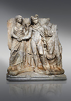 Roman Sebasteion releif sculpture of emperor Claudius and Agrippina, Aphrodisias Museum, Aphrodisias, Turkey. <br /> <br /> Claudius in heroic nudity and military cloak shakes hands with his wife Agrippina and is crowned by the Roman people or the Senate wearing a toga. The subject is imperial concord with the traditional Roman state. Agrippina holds ears of wheat: like Demeter goddess of fertility. The emperor is crowned with an oak wreath, the Corona civica or &ldquo;citizen crow&rdquo;, awarded to Roman leaders for saving citizens lives: the emperor id therefore represented as saviour of the people.