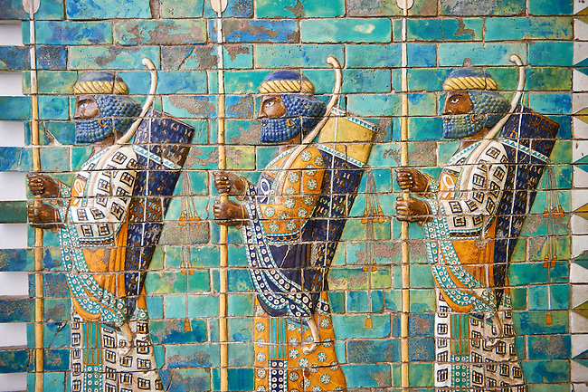 Coloured glazed terracotta brick panels depicting Achaemenid Persian royal bodyguards or archers. From the reign of Darius 1st and the First Persian or Achaemenid Empire around 510 BC excavated from the Palace of Daius 1st. Susa was one of the residential cities of the Achaemenid Kings. The Palaces are noteworthy for their elaborate decorations which can be considered exemplary of art at a royal court. The walls of Darius's palace at Susa were embellished with colourful reliefs made from glazed bricks on the Babylonian model. It is not certain which rooms of the palace was decorated with representations of a procession of royal bodyguards or archers, dressed in richly decorative costumes.  The Vorderasiatisches Museum, part of the Pergamon Museum, Berlin