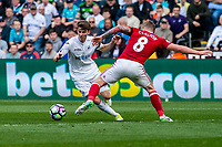 Sunday April 02 2017 <br /> Pictured: Tom Carroll of Swansea City in action <br /> Re: Premier League match between Swansea City and Middlesbrough at The Liberty Stadium, Swansea, Wales, UK. SUnday 02 April 2017
