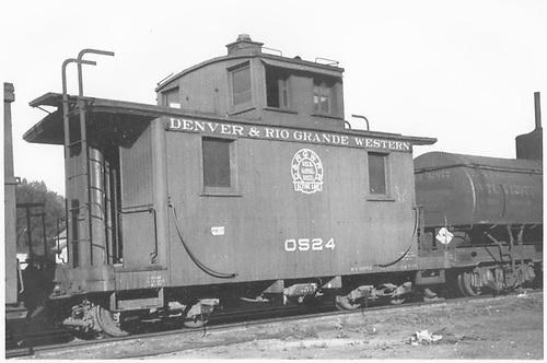 Short caboose #0524 and tank car #12977.<br /> D&amp;RGW