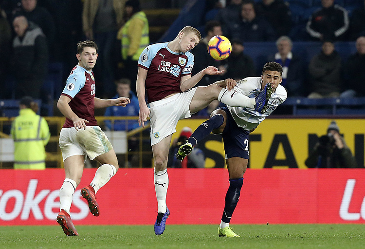 Burnley's Ben Mee vies for possession with Everton's Dominic Calvert-Lewin<br /> <br /> Photographer Rich Linley/CameraSport<br /> <br /> The Premier League - Burnley v Everton - Wednesday 26th December 2018 - Turf Moor - Burnley<br /> <br /> World Copyright © 2018 CameraSport. All rights reserved. 43 Linden Ave. Countesthorpe. Leicester. England. LE8 5PG - Tel: +44 (0) 116 277 4147 - admin@camerasport.com - www.camerasport.com