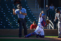 Umpire Ryan Goodman makes a call as catcher Jose Trevino throws the ball back to the pitcher delivers a pitch during an Arizona Fall League game between the Glendale Desert Dogs and Surprise Saguaros on October 23, 2015 at Salt River Fields at Talking Stick in Scottsdale, Arizona.  Glendale defeated Surprise 9-6.  (Mike Janes/Four Seam Images)