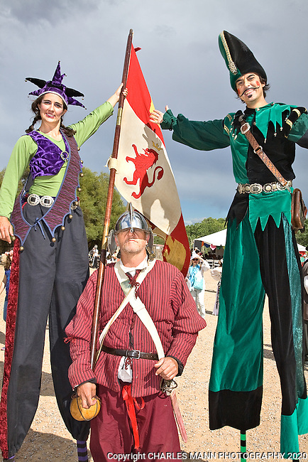 The Renaissance Fair is held each September at the historic museum of El Rancho de Las Golondrinas near Santa Fe and features dancers, kinghts, acrobats and many other performers all celebrating the culture and life style of the Medieval Middle Ages. Recbecca and Santiago of Clan Tynker pose with a Guard.
