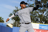 Tampa Yankees outfielder Mason Williams #14 warms up before a game against the Dunedin Blue Jays on April 11, 2013 at Florida Auto Exchange Stadium in Dunedin, Florida.  Dunedin defeated Tampa 3-2 in 11 innings.  (Mike Janes/Four Seam Images)