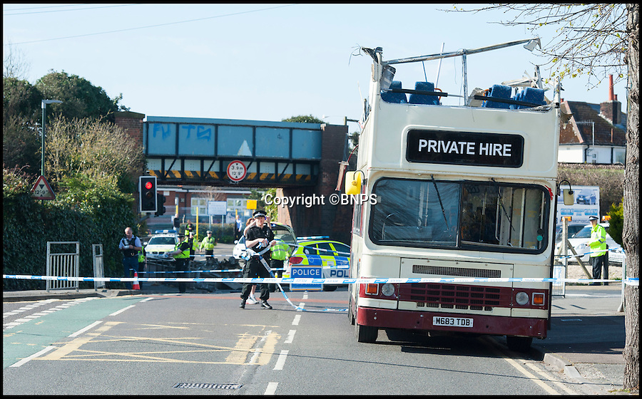BNPS.co.uk (01202 558833)<br /> Pic: TomWren/BNPS<br /> <br /> Students had a miraculous escape today after the roof of a double decker bus sheared off when it ploughed into a railway bridge next to a primary school.<br /> <br /> Teenagers on the top deck ducked at the moment the vehicle crashed, ripping off the headrests of their seats and slicing off the roof.<br /> <br /> The dramatic collision occurred just as hundreds of young children arrived at the primary school in Bournemouth with many lucky not to have been hit by the roof as it fell onto the road or by debris.