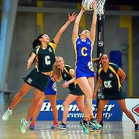 Action from the 2015 National Netball Championship match between Dunedin (blue and yellow) and Hutt Valley (green and gold) at ASB Sports Centre, Kilbirnie, Wellington, New Zealand on Tuesday, 29 September 2015. Photo: Dave Lintott / lintottphoto.co.nz