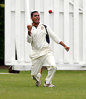 Vimal Arjan celebrates after taking a Brondesbury wicket during the Middlesex Cricket League Division Two game between Brondesbury and Wembley at Harman Drive, London on Sat Aug 1, 2015