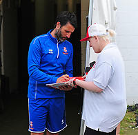 Lincoln City manager Danny Cowley signs an autograph for a fan<br /> <br /> Photographer Andrew Vaughan/CameraSport<br /> <br /> The EFL Sky Bet League Two Play Off First Leg - Lincoln City v Exeter City - Saturday 12th May 2018 - Sincil Bank - Lincoln<br /> <br /> World Copyright &copy; 2018 CameraSport. All rights reserved. 43 Linden Ave. Countesthorpe. Leicester. England. LE8 5PG - Tel: +44 (0) 116 277 4147 - admin@camerasport.com - www.camerasport.com