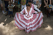 Para State, Brazil. A couple in traditional dress dancing Carimbo at a celebration in the poor rural settler community of São Domingos, in the Tapajos National Forest Park.