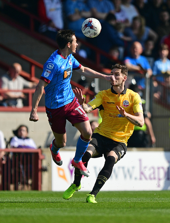 Scunthorpe United's Josh Morris vies for possession with Bolton Wanderers' Dorian Dervite<br /> <br /> Photographer Chris Vaughan/CameraSport<br /> <br /> The EFL Sky Bet League One - Scunthorpe United v Bolton Wanderers - Saturday 8th April 2017 - Glanford Park - Scunthorpe<br /> <br /> World Copyright &copy; 2017 CameraSport. All rights reserved. 43 Linden Ave. Countesthorpe. Leicester. England. LE8 5PG - Tel: +44 (0) 116 277 4147 - admin@camerasport.com - www.camerasport.com