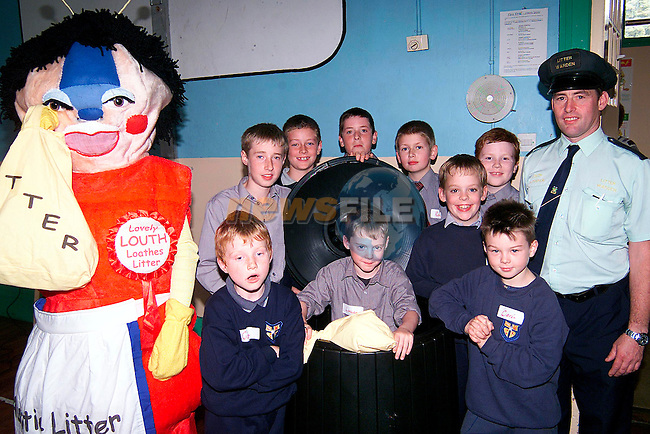 Gavin Douglas, Lorcan Myles, Ciaran Lowry, Conor Callaghan, Robert Mccabe, James McMahon, Oisin Clarke and Daniel Farrell with Auntie Litter Bug and Louth Litter Warden Martin Reilly in Ardee Boys Monastery School..Picture: Paul Mohan/Newsfile