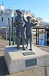 Sculpture by Jeanne Rynhart, outside Heritage Centre, Cobh, County Cork, Ireland, Irish Republic - Annie Moore and her brothers Anthony and Philip were the first emigrants processed at Ellis Island, USA on 1 January 1892