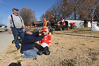 NWA Democrat-Gazette/FLIP PUTTHOFF <br /> CHRISTMAS ON WHEELS<br /> Robert Storey (left) and Nahdean Albrecht (cq) work on a Christmas lights display that features antique cars Storey owns and restores at his home on Price Lane in Rogers. Storey uses different cars each Christmas season. This year's attractions include a 1930 Model A roadster with a trailer. Storey will drive one of his cars in the Rogers Christmas Parade set for 7 p.m. Dec. 7 through downtown Rogers.