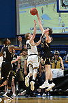 SALEM, VA - MARCH 17: Nebraska Wesleyan Prairie Wolves forward Cooper Cook (30) blocks the shot of Wisconsin-Oshkosh Titans forward Connor Duax (20) during the Division III Men's Basketball Championship held at the Salem Civic Center on March 17, 2018 in Salem, Virginia. Nebraska Wesleyen defeated Wisconsin-Oshkosh 78-72 for the national title. (Photo by Andres Alonso/NCAA Photos/NCAA Photos via Getty Images)