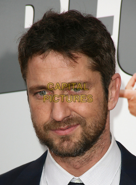 GERARD BUTLER .At the New York City film premiere of 'The Bounty Hunter' at Ziegfeld Theatre in New York City, NY, USA, .March 16, 2010 .arrivals portrait headshot navy blue white beard facial hair .CAP/ADM/PZ.©Paul Zimmerman/Admedia/Capital Pictures