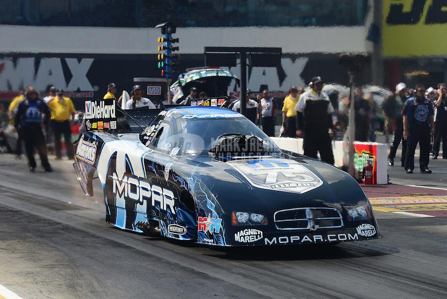 Sept. 15, 2012; Concord, NC, USA: NHRA funny car driver Matt Hagan during qualifying for the O'Reilly Auto Parts Nationals at zMax Dragway. Mandatory Credit: Mark J. Rebilas-