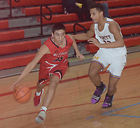 RICK PECK/SPECIAL TO MCDONALD COUNTY PRESS<br /> McDonald County's Saul Garcia drives past Monett's Trevon Price during the Mustangs' 58-51 win on Feb. 25 in the Missouri Class 4 District 12 Boys Basketball Tournament at Webb City High School.