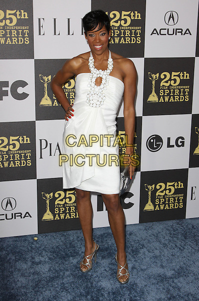 REGINA KING .25th Annual Film Independent Spirit Awards held At The Nokia LA Live, Los Angeles, California, USA,.March 5th, 2010 ..arrivals Indie Spirit full length white dress hand on hip halterneck cut out ruffle embellished silver strappy sandals open toe clutch bag .CAP/ADM/KB.©Kevan Brooks/Admedia/Capital Pictures