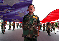 "O.parade.1.0702.jl.jpg/photo Jamie Scott Lytle/Ten year old Raymond Rodriguez of Camp Pendleton yells ""Yes Sir"" when asked if he and the other Young Marines if they are ready to start marching in the 12th Annual Freedom Days parade held in Oceanside Saturday. The Young Marine youth group carries a giant American Flag every year in the annual event."