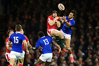 Leigh Halfpenny of Wales under pressure from Teddy Thomas of France during the Guinness Six Nations Championship Round 3 match between Wales and France at the Principality Stadium in Cardiff, Wales, UK. Saturday 22 February 2020
