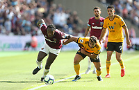 West Ham United's Michail Antonio and Wolverhampton Wanderers' Jonny<br /> <br /> Photographer Rob Newell/CameraSport<br /> <br /> The Premier League - West Ham United v Wolverhampton Wanderers - Saturday 1st September 2018 - London Stadium - London<br /> <br /> World Copyright © 2019 CameraSport. All rights reserved. 43 Linden Ave. Countesthorpe. Leicester. England. LE8 5PG - Tel: +44 (0) 116 277 4147 - admin@camerasport.com - www.camerasport.com