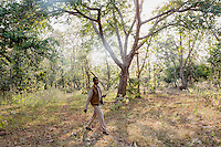 A worker with a walkie-talkie patrols in the Panna Tiger Reserve.