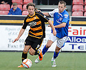 Alloa's Stevie May gets away from Stranraer's Scott Taggart.